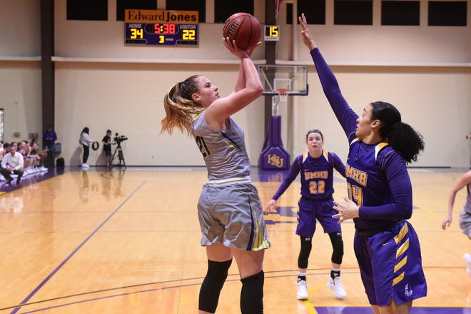 HSU's Kaitlyn Ellis (21) puts up a shot on Saturday afternoon. Ellis scored 10 points and blocked the final shot as the Cowgirls upset No. 6 Mary Hardin-Baylor 61-59.