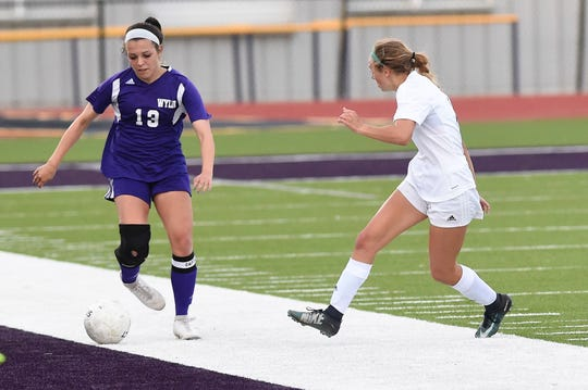 Wylie's Kalli Hanson (13) beats an Odessa Permian defender to the sideline in a 2019 game. Following her senior season with the Lady Bulldogs, Hanson will continue her career at McMurry.