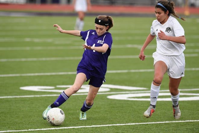Wylie's Britain Downs (4) turns from an Odessa Permian defender at Bulldog Stadium on Friday, Feb. 1, 2019. The Lady Bulldogs fell 3-1.