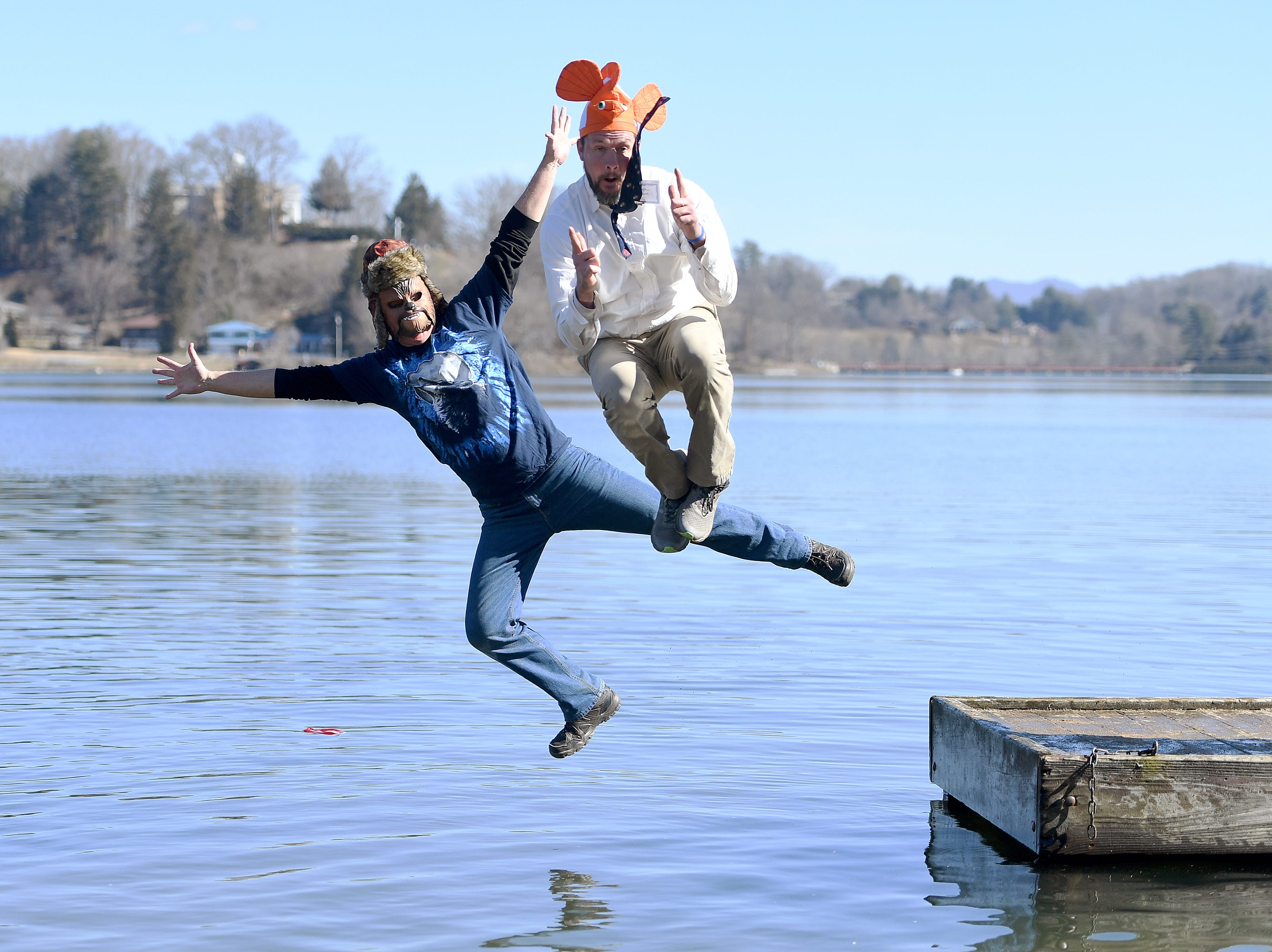Bill Eaker, left, chair of the fundraising committee of Haywood Waterways, and Eric Romaniszyn, executive director of the non-profit, are the last ones to leap into the chilly waters of Lake Junaluska during the 7th Annual Plunge at Lake Junaluska Conference and Retreat Center on Feb. 2, 2019. The event raised more than $30,000 for Kids in the Creek and environmental education.