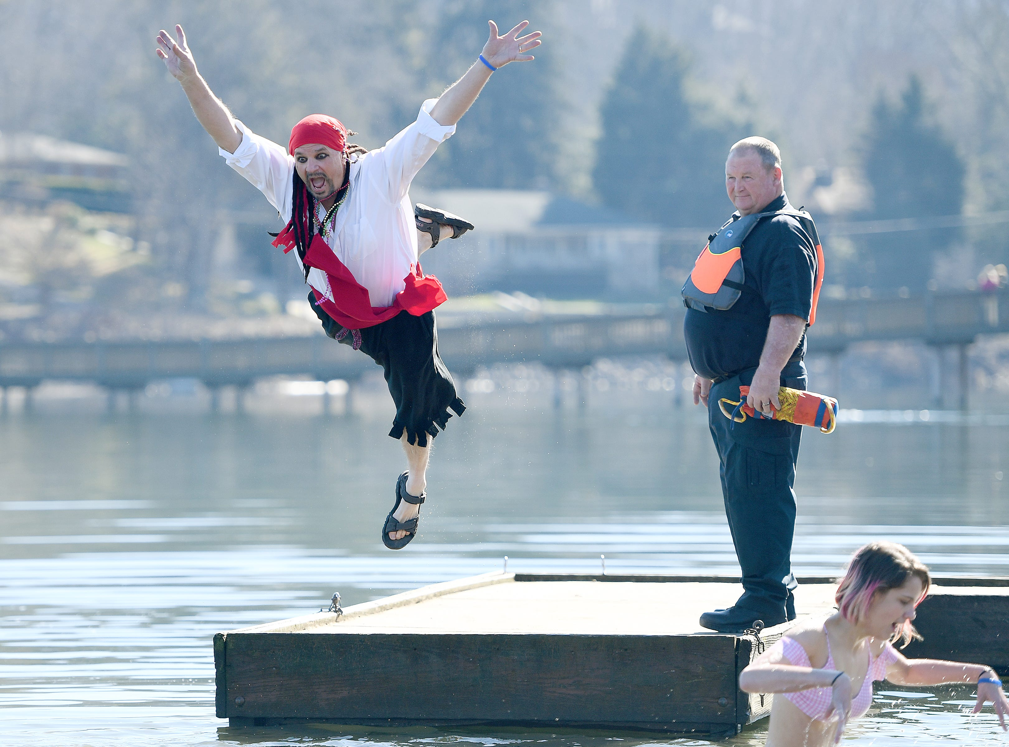 Steve Winchester makes a leap into the chilly waters of Lake Junaluska during the 7th Annual Plunge at Lake Junaluska Conference and Retreat Center on Feb. 2, 2019. The event raised more than $30,000 for Kids in the Creek and environmental education.
