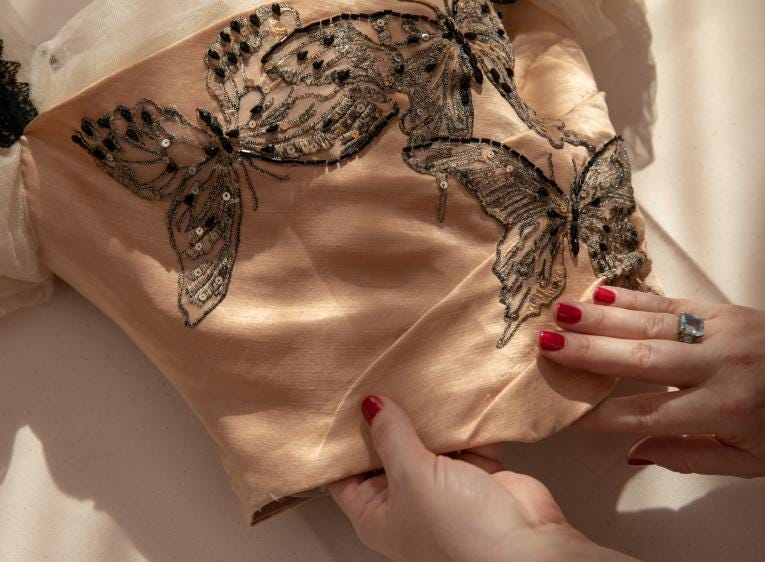Detail of the embroidery and faceted beading stitched to create the butterflies on the reproduction of a 1900-era dress worn by Florence Vanderbilt Twombly, George Vanderbilt's sister. Academy Award-winning costume designer John Bright and Cosprop, London, recreated the dress.