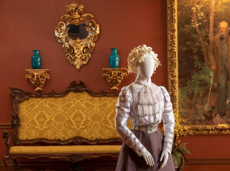 Stationed in the Second Floor Living Hall of Biltmore House is the reproduction of a 1900-era skirt and shirt worn by Edith Vanderbilt. Clothing recreated by Academy Award-winning costume designer John Bright and Cosprop, London.