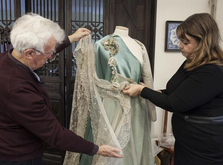 "John Bright, Academy Award-winning costume designer, works on a recreated dress for ""A Vanderbilt House Party - The Gilded Age"" with Leslie Klingner, Biltmore's curator of interpretation, at his London-based company Cosprop."