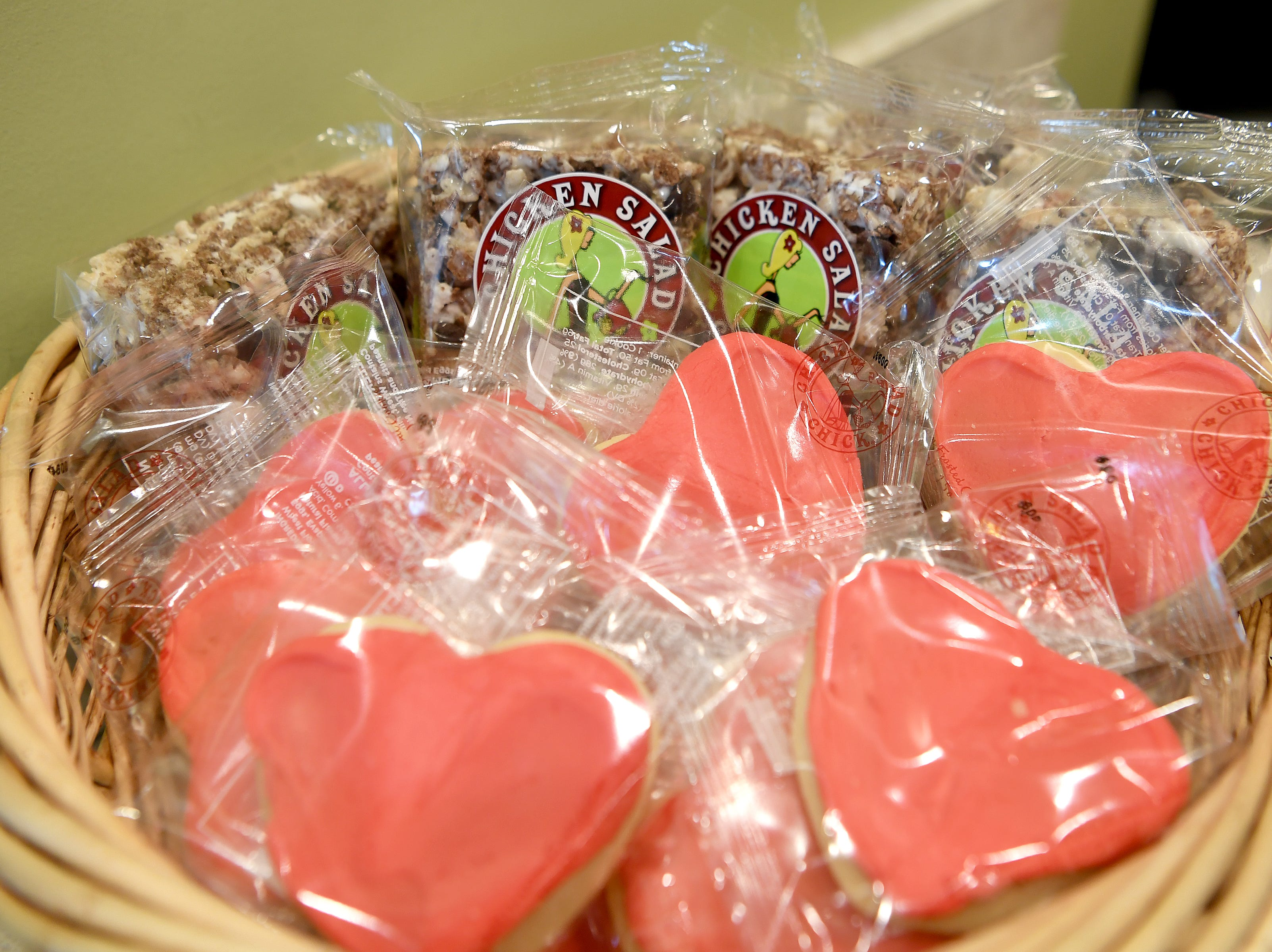 A basket of sweets sits on the counter at Chicken Salad Chick.