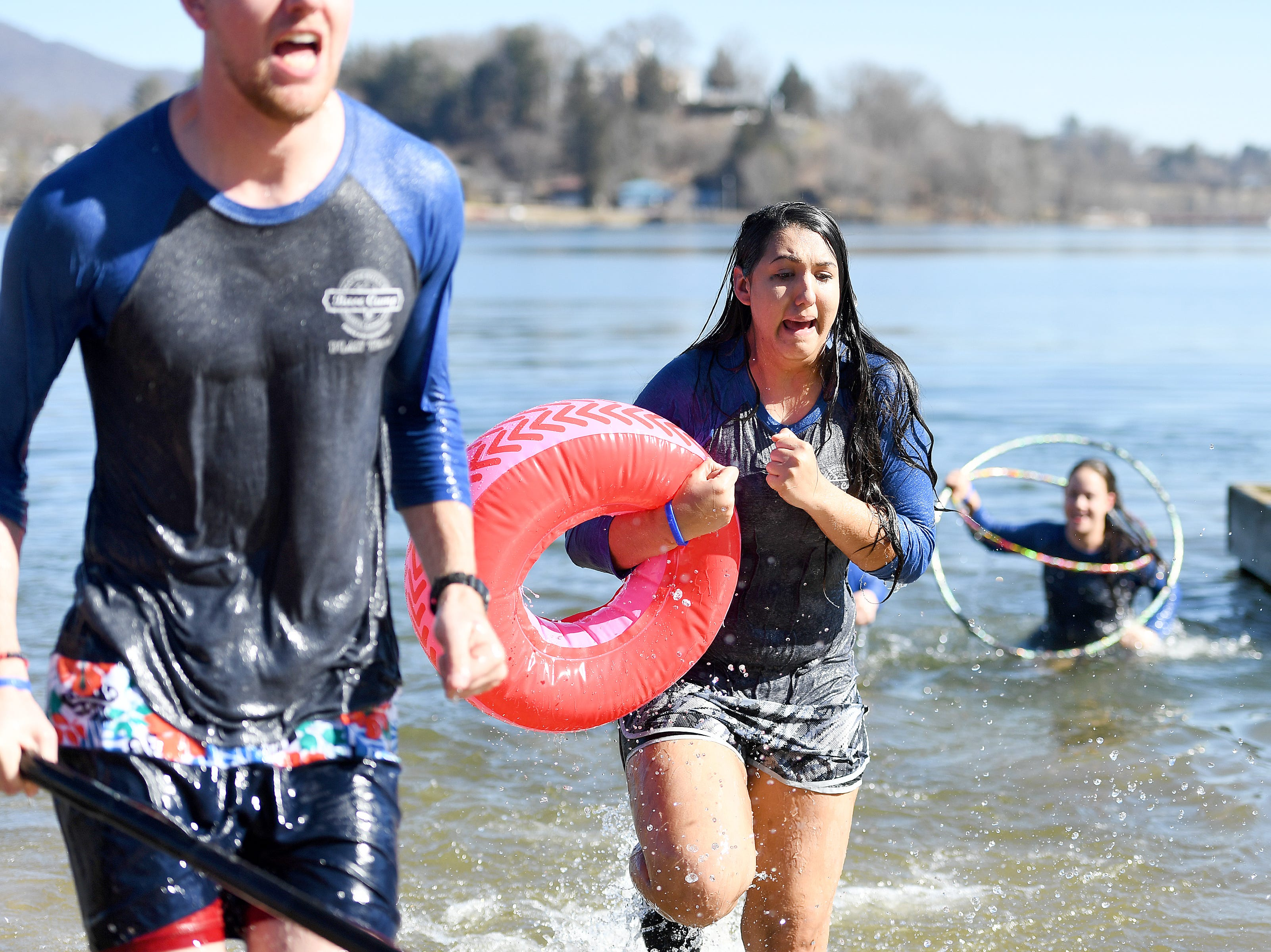 Tori Bugg runs from the chilly water of Lake Junaluska after jumping from the dock with On the Go Basecamp during the 7th Annual Plunge at Lake Junaluska Conference and Retreat Center on Feb. 2, 2019. The event raised more than $30,000 for Kids in the Creek and environmental education.