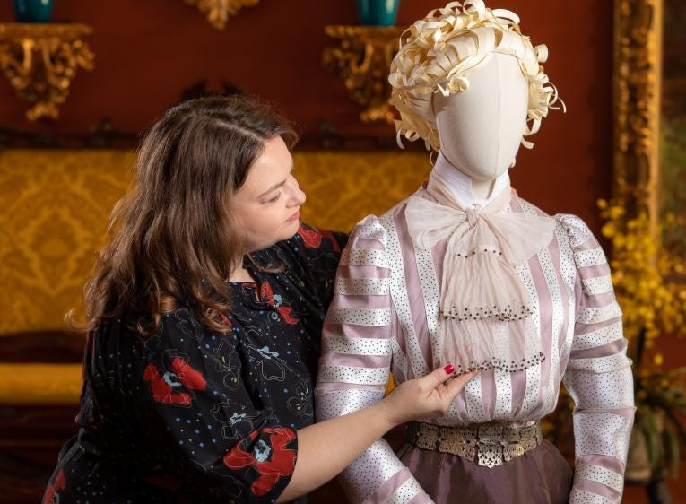 Leslie Klingner, Biltmore's Curator of Interpretation, adjusts the bow on Edith Vanderbilt's 1900-era blouse, re-created by Academy Award-winning costume designer John Bright and Cosprop, London.