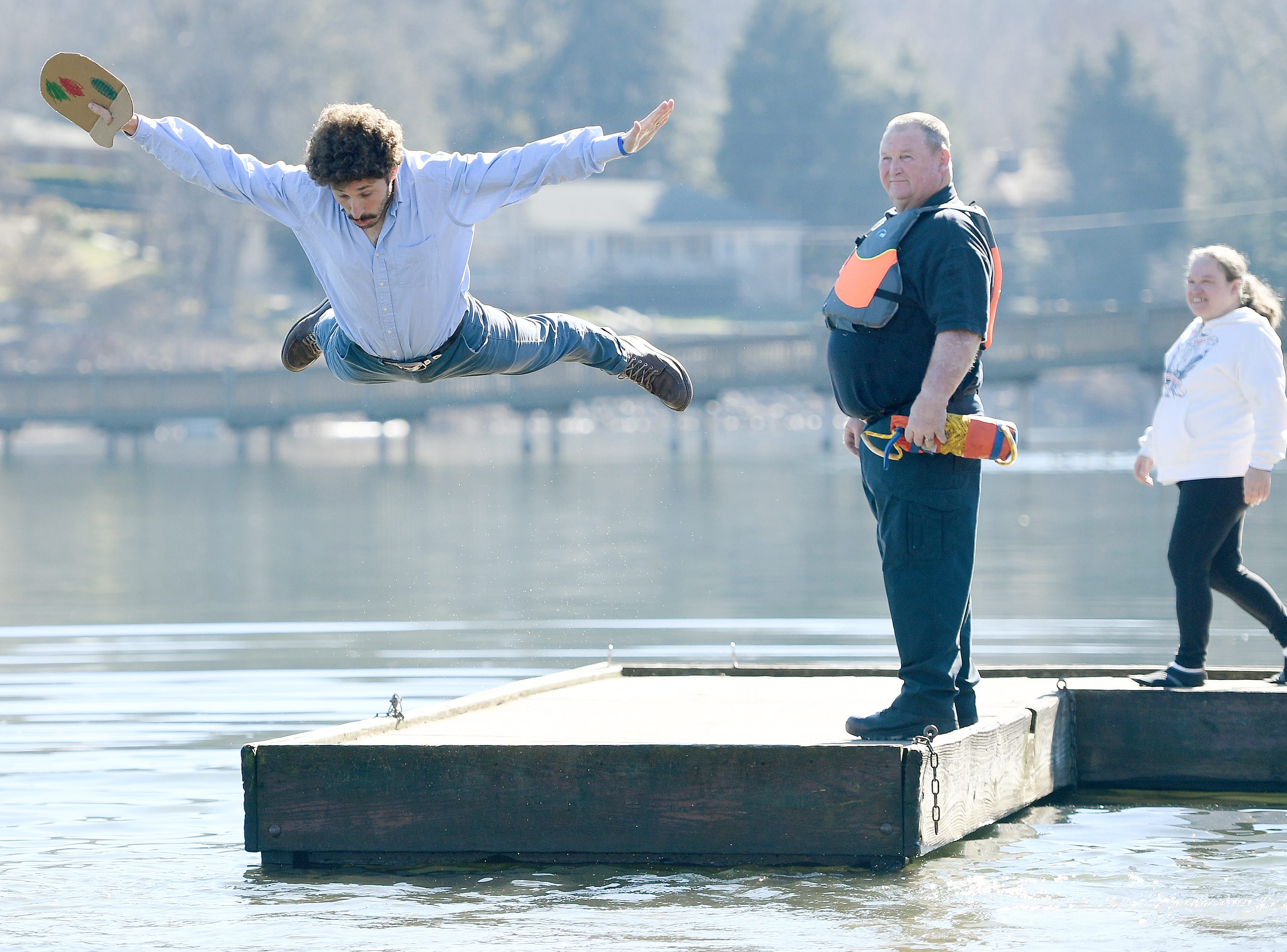 Andrew Bowen, dressed as television painting instructor Bob Ross, leaps into the chilly waters of Lake Junaluska during the 7th Annual Plunge at Lake Junaluska Conference and Retreat Center on Feb. 2, 2019. Bowen won the costume contest and was also a top fundraiser for the event.