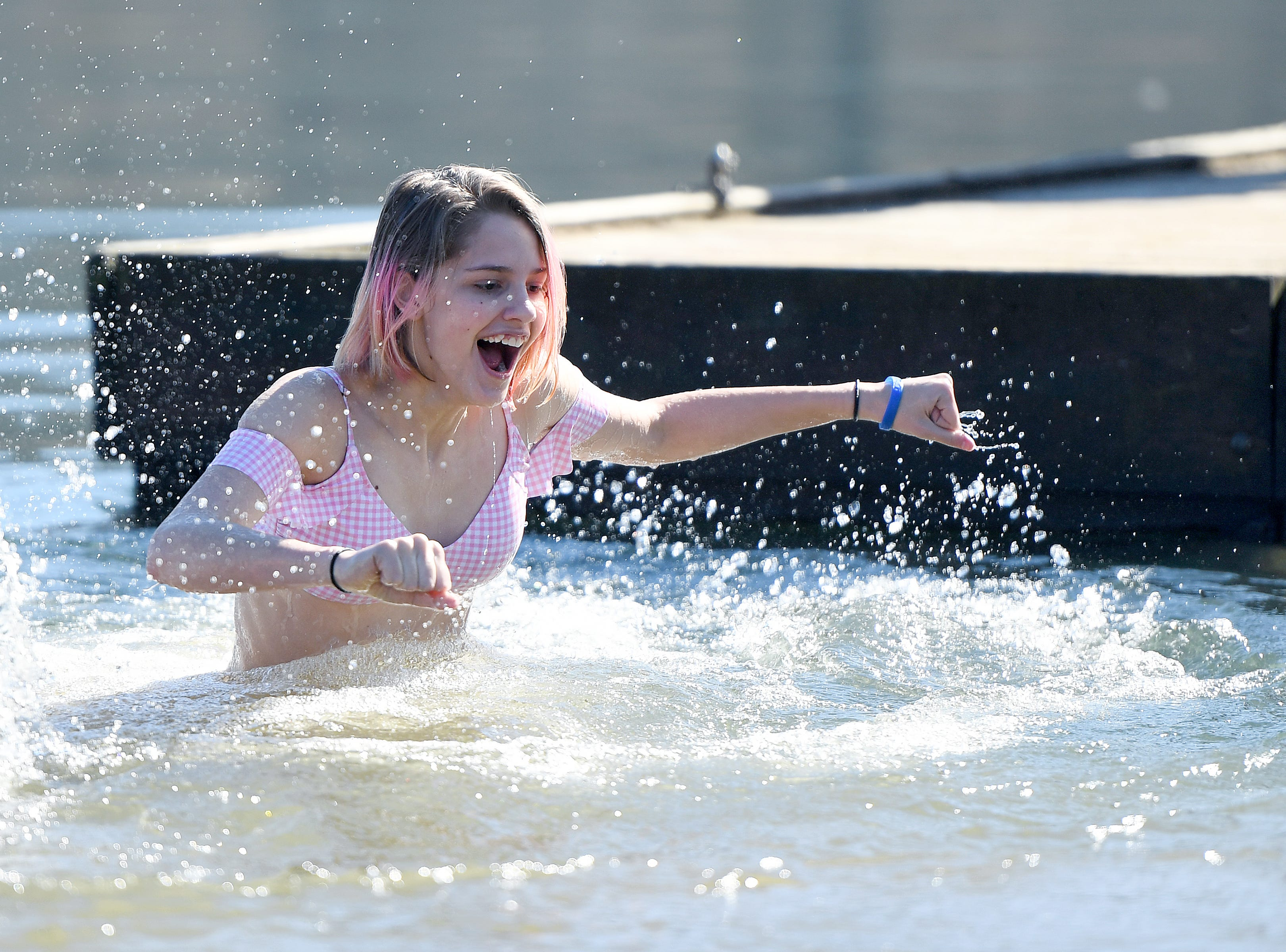 Cami Phillips, 15, makes her way out of the chilly waters of Lake Junaluska after jumping from the dock during the 7th Annual Plunge at Lake Junaluska Conference and Retreat Center on Feb. 2, 2019. The event raised more than $30,000 for Kids in the Creek and environmental education.