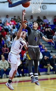 Owego's Christian Sage (1) attempt's to block M-E's Michael Mancini (4) as he goes up to score during the first period of  Maine-Endwell High School at Owego Free Academy boys varsity basketball. Friday, February 1, 2019.