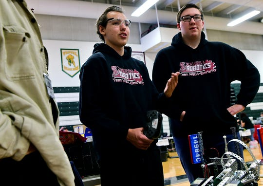 Donte Hare, a junior at Elmira High School, discusses his team's robot during the Elmira Express VEX Turning Point, held on Saturday, February 2, 2019, at Elmira High School.