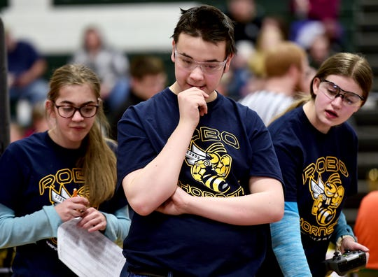 Jordan Gillette, Brennan Mann and Samantha Gillette, students at Harpursville High School, during the Elmira Express VEX Turning Point, held on Saturday, February 2, 2019, at Elmira High School.