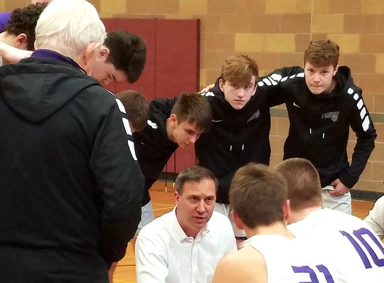 North Kitsap boys basketball coach Scott Orness talks to his team during Saturday's Olympic League 2A tiebreaker game against Port Angeles. The Roughriders beat the Vikings 68-64.