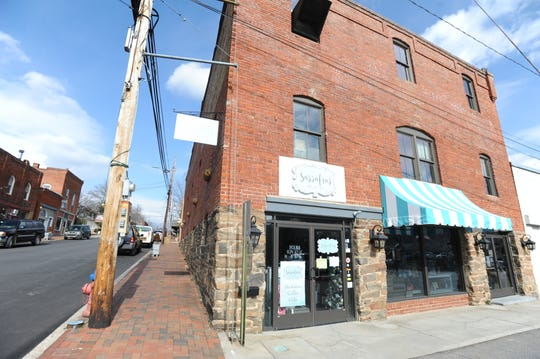 Sassafras on Sutton and Poppy Handcrafted Popcorn were forced out of the historic building they share in downtown Black Mountain when the roof collapsed on Dec. 11. It will be months until either is able to resume operations in the building.