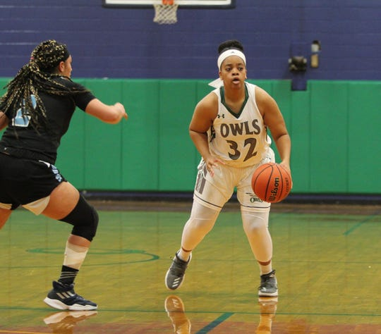 Senior Amber Godfrey handles the ball for Owls as Warren Wilson hands Piedmont International a 77-75 defeat on Jan. 25.