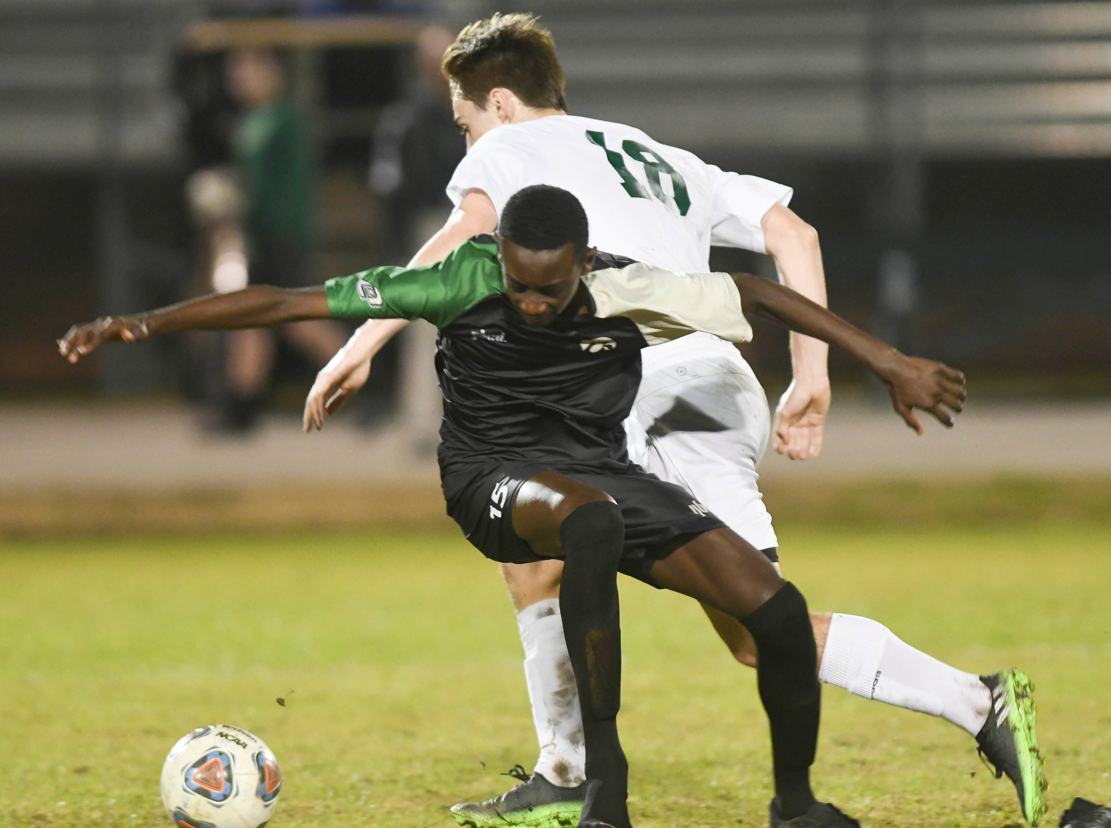 Melbourne's Cooper Bywater and Nyles Lockridge of Viera battle during Friday's game at Viera High.
