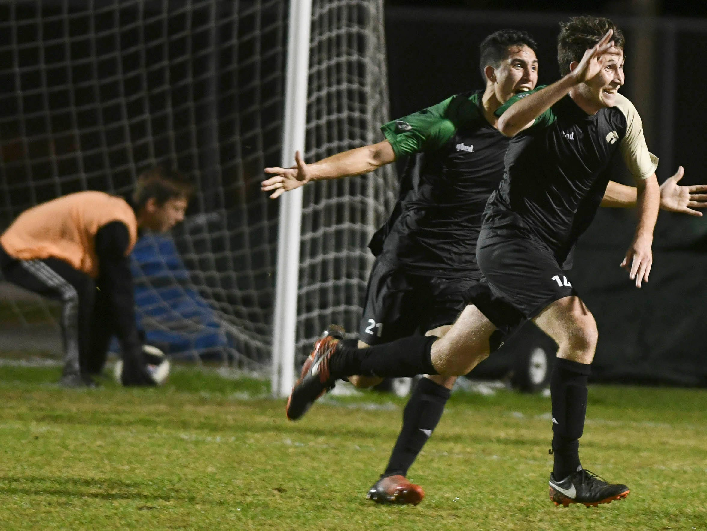 Patrick Murtha and Stephen McHale of Viera celebrate Murtha's goal during Friday's Class 4A, District 6 championship game against Melbourne.