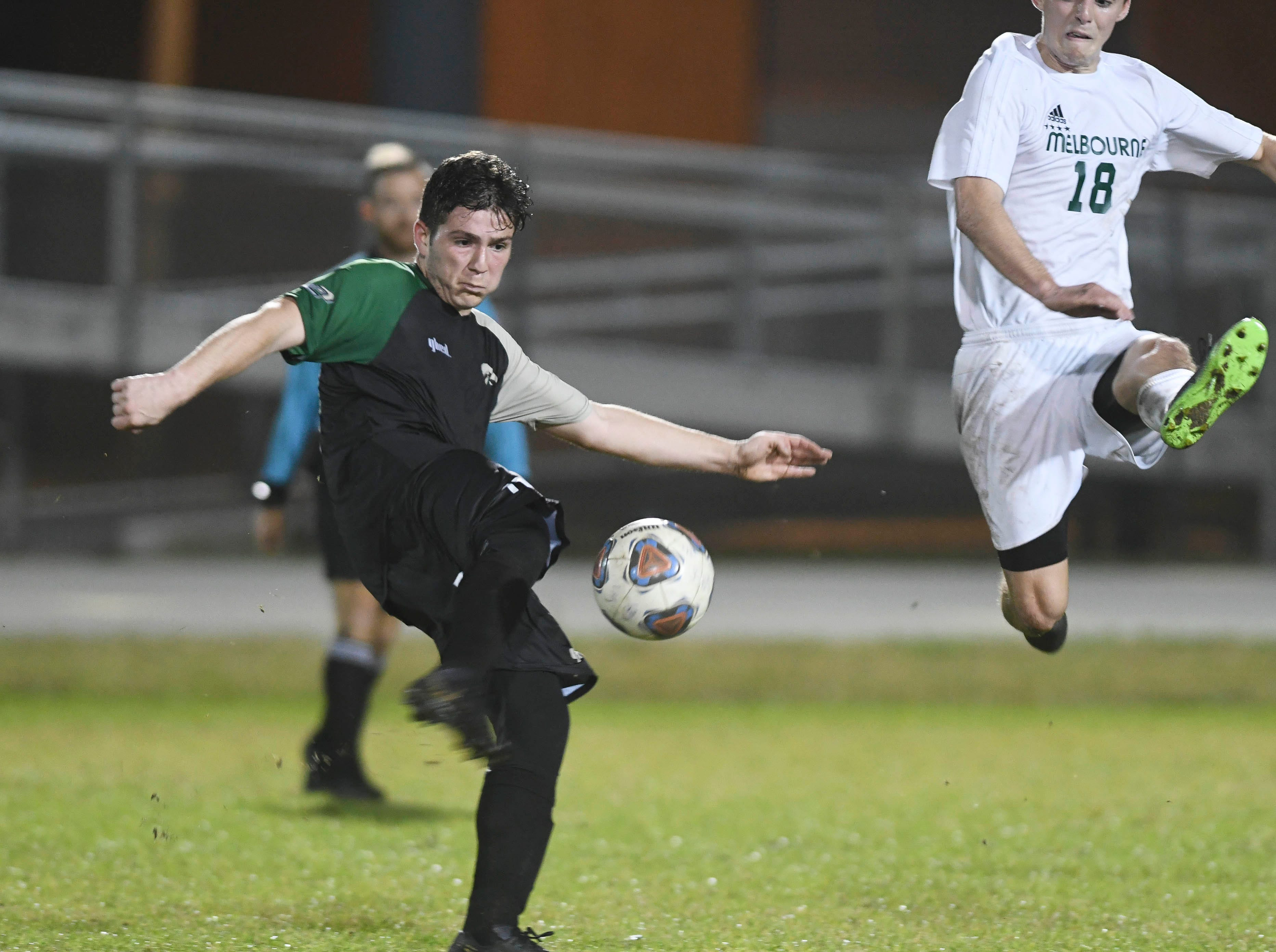 Christian Becerra of Viera drives the ball away from Cooper Bywater of Melbourne during Friday's game at Viera High.