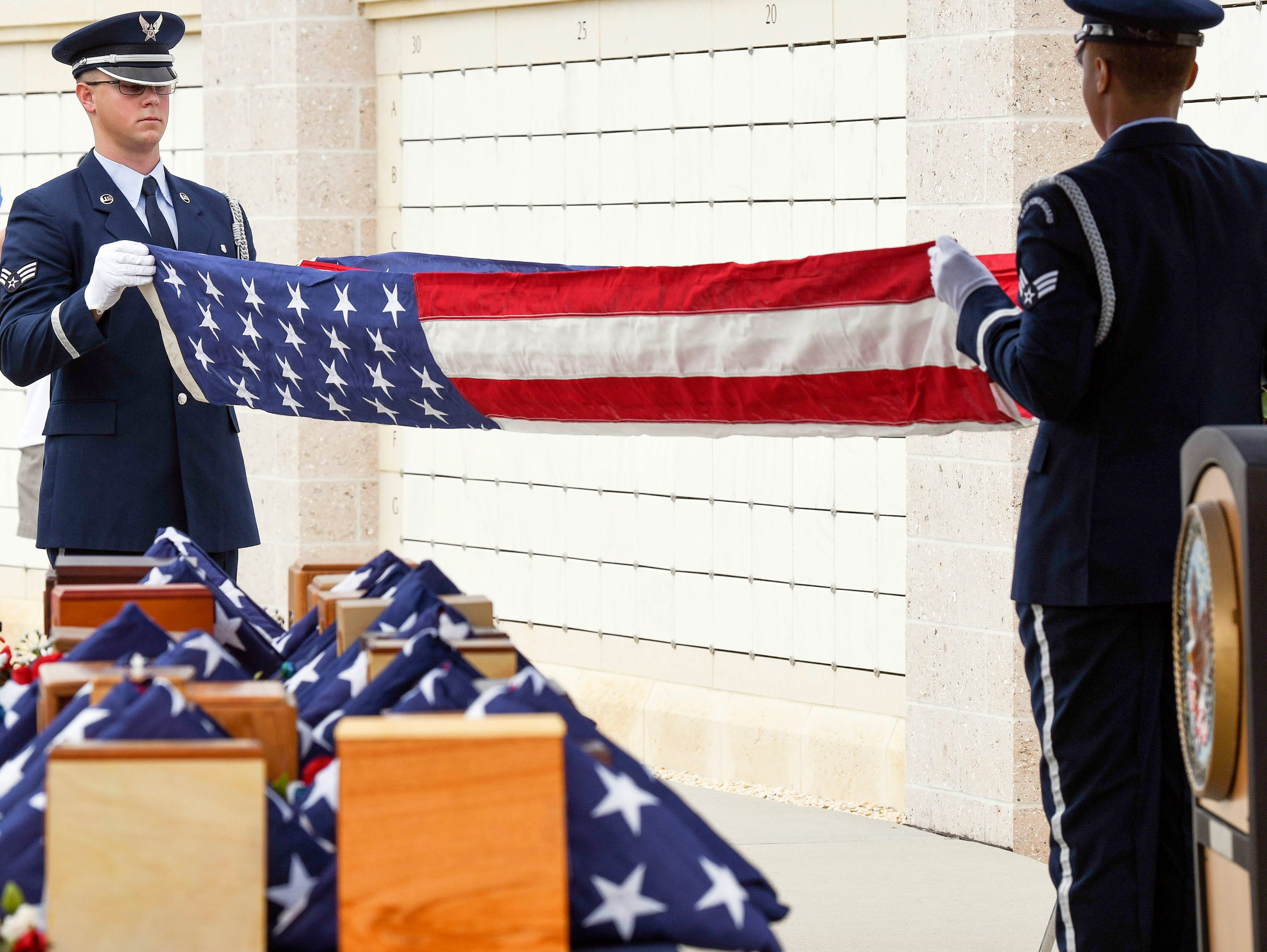 The ashes of 19 veterans and six spouses are laid to rest in a ceremony Saturday lat Cape Canaveral National Cemetery. The Missing in America Project heads up the effort to locate and inter the unclaimed cremains of veterans throughout the country.