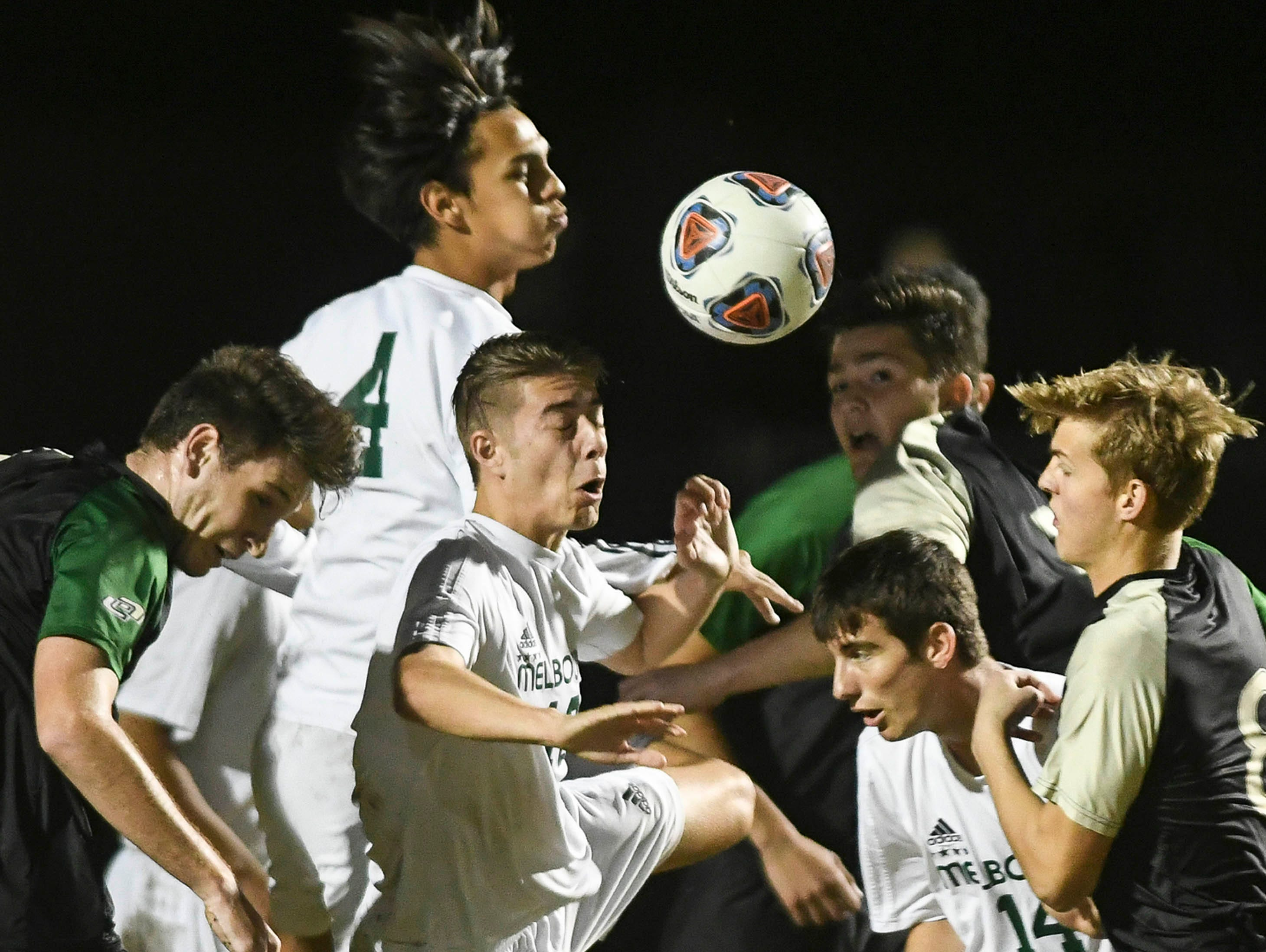 Melbourne and Viera players contend for the ball during Friday's district championship game at Viera High.