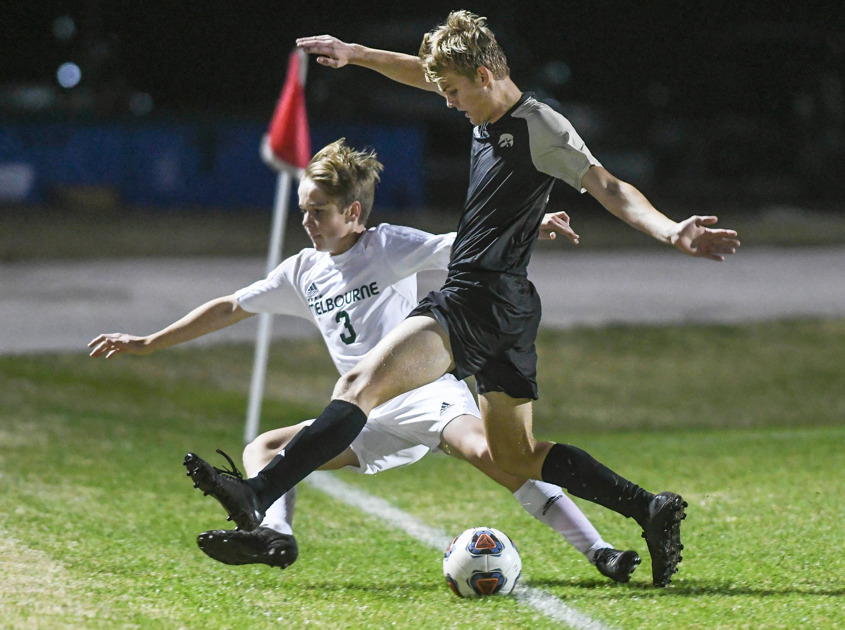 Melbourne's Luke Russo and Mads Jensen of Viera contend for the ball at the sideline during Friday's game at Viera High.