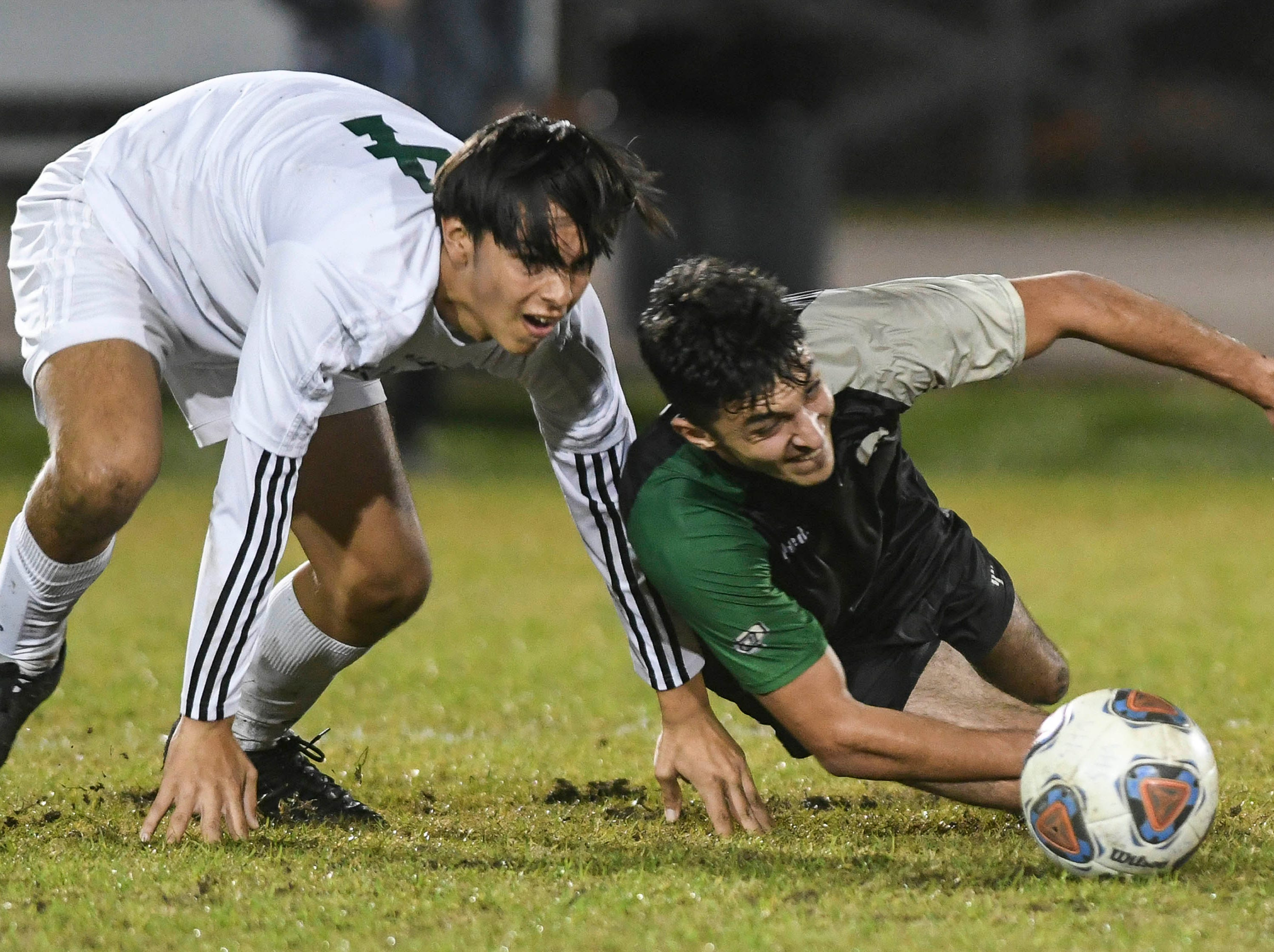 Nick Martinez of Melbourne and Kia Mohajeri of Viera scramble for the ball during Friday at Viera High.'s Class 4A, District 6 championship game.