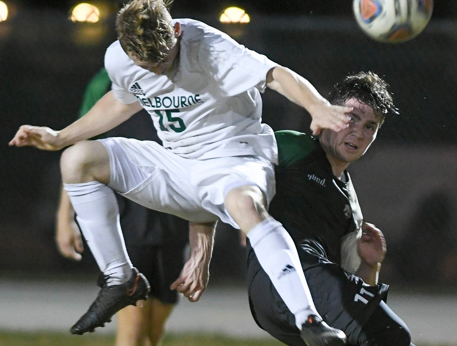 Melbourne's Logan Kraus contends for the ball with Viera's Christian Becerra during Friday's game at Viera High.