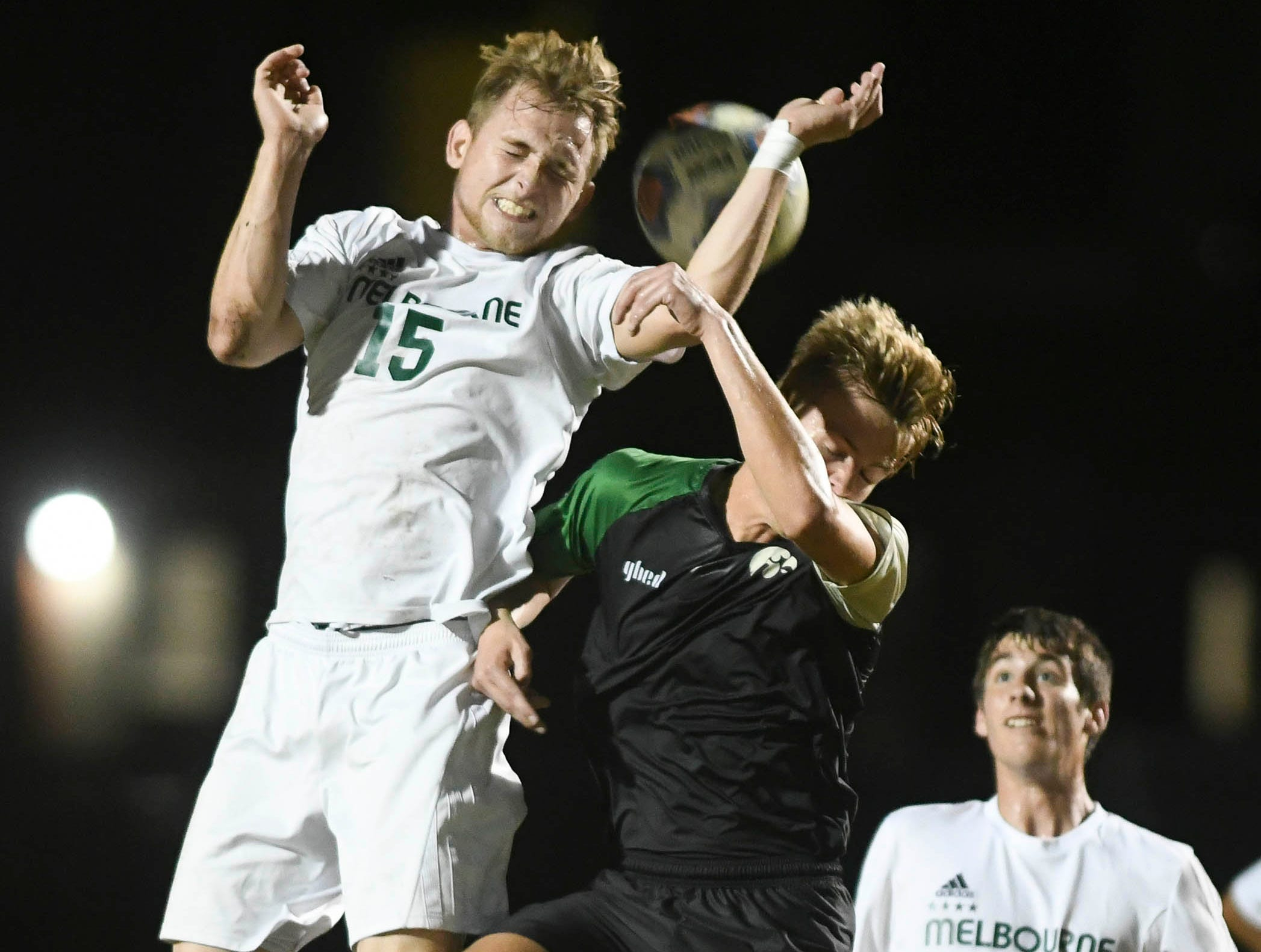 Melbourne's Logan Kraus (15) and Viera's Mads Jensen go up for a header during Friday's game at Viera High.