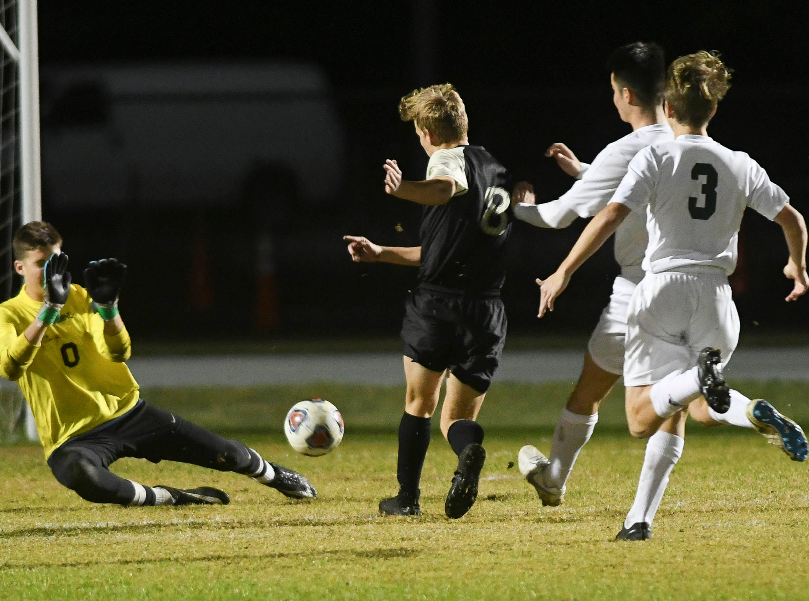 Melbourne goalkeeper Zach Browne makes a save during Friday's district championship game at Viera High.