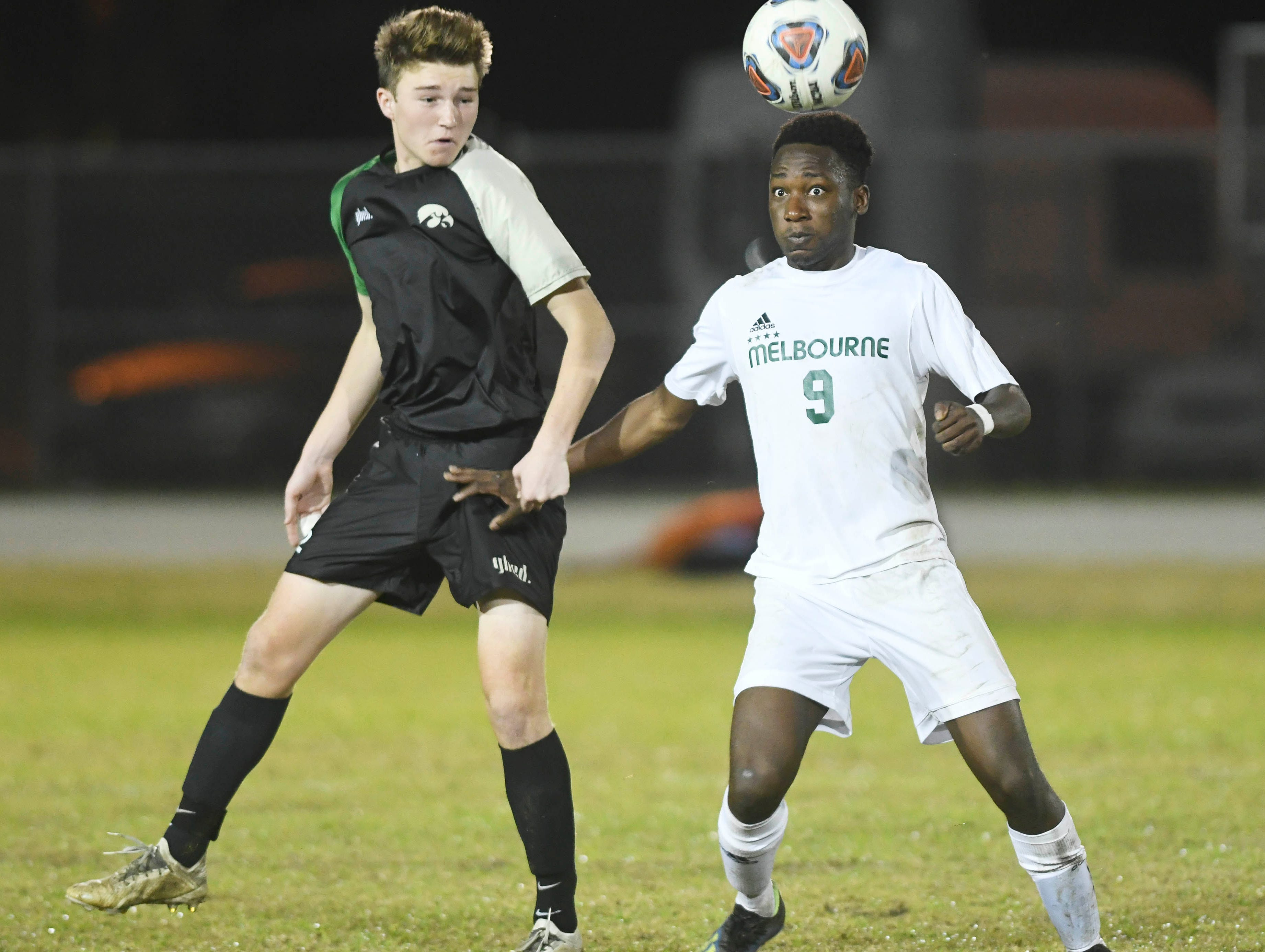 Viera's Evan Kirrane (left) and Osas Osaro of Melbourne look to control the ball during Friday's district championship game at Viera High.