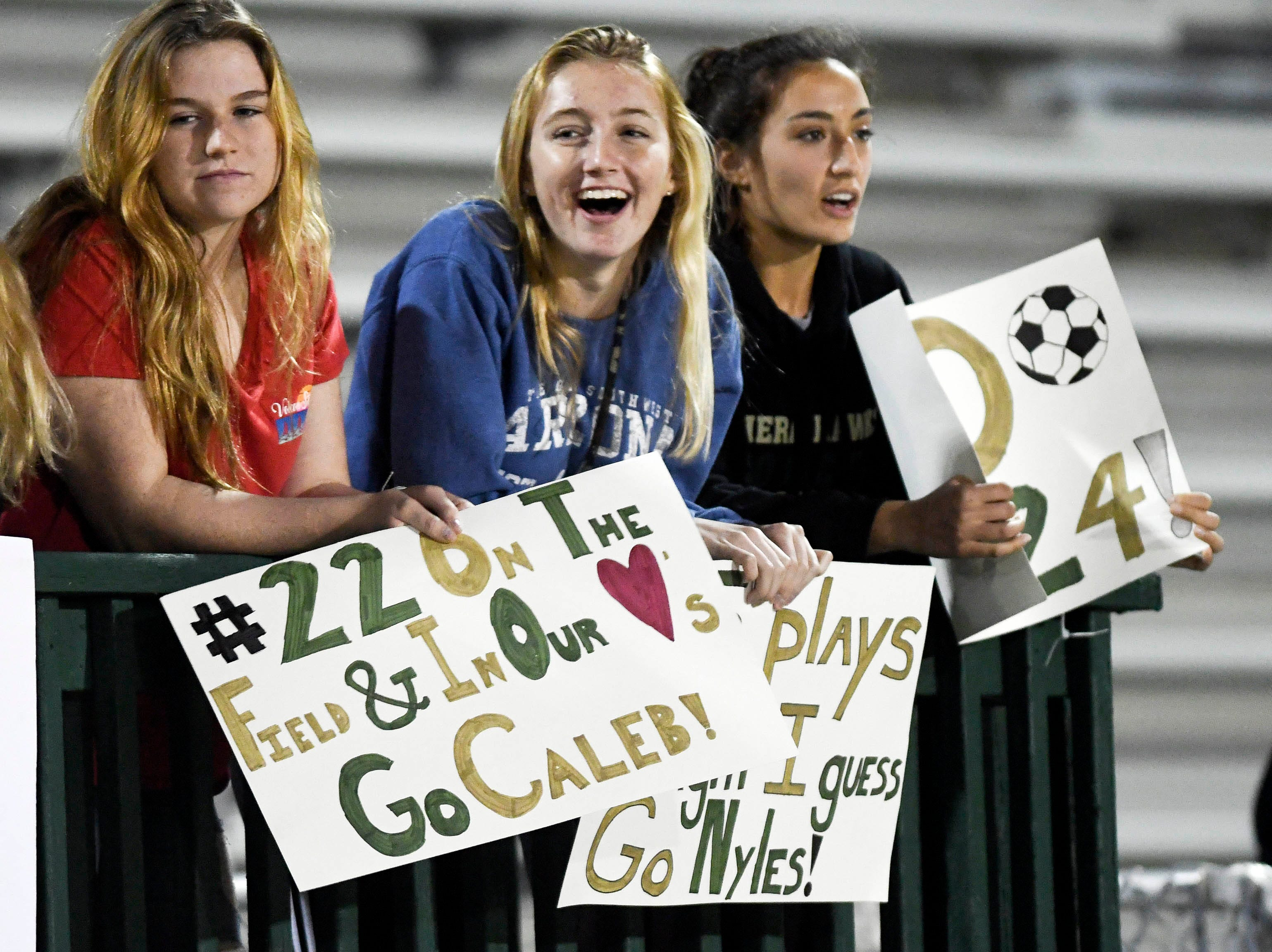 Fans cheer for the Hawks during Friday's game at Viera High.