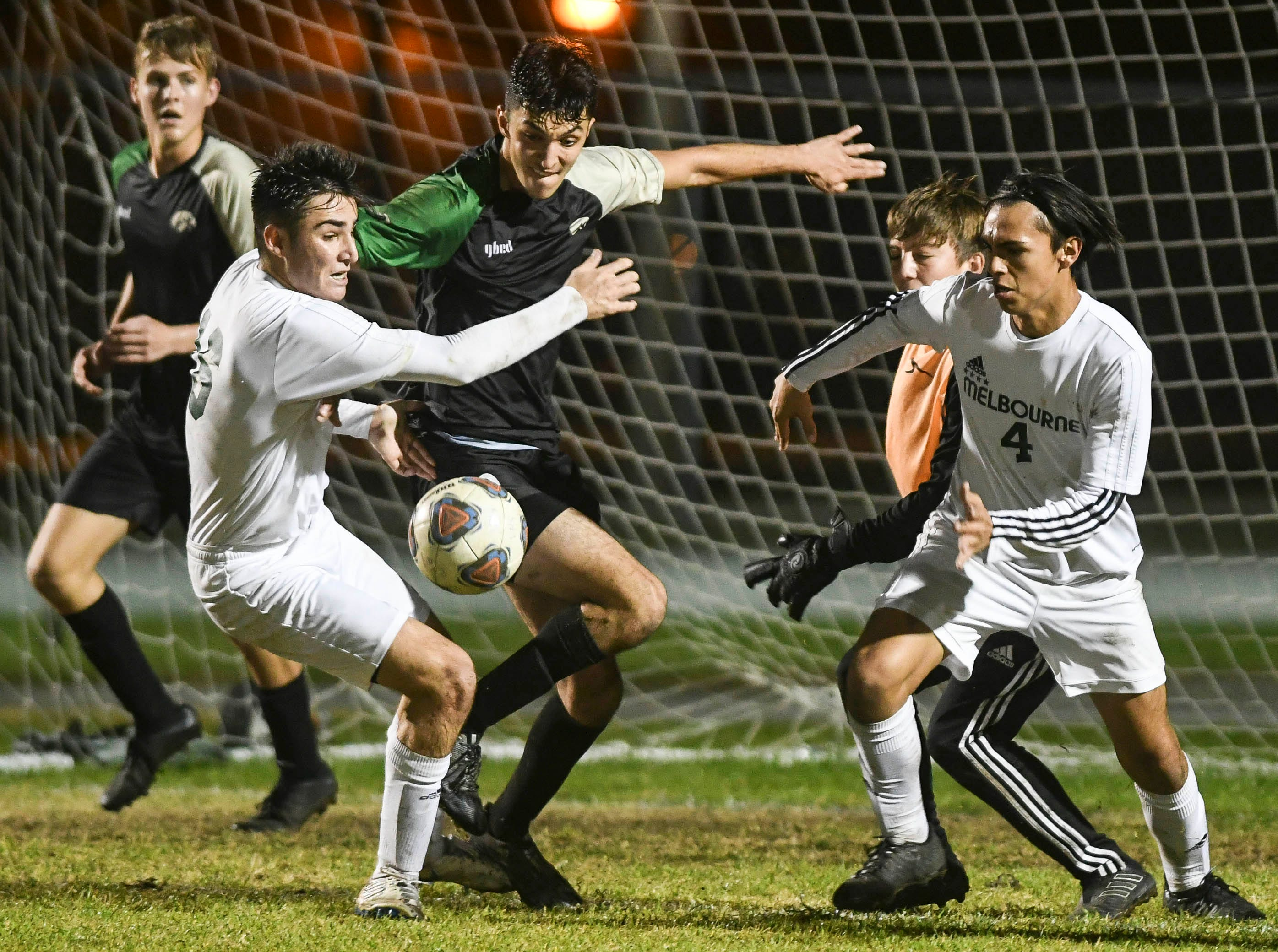 Melbourne and Viera players battle for the ball in front of the Melbourne goal during Friday's game.