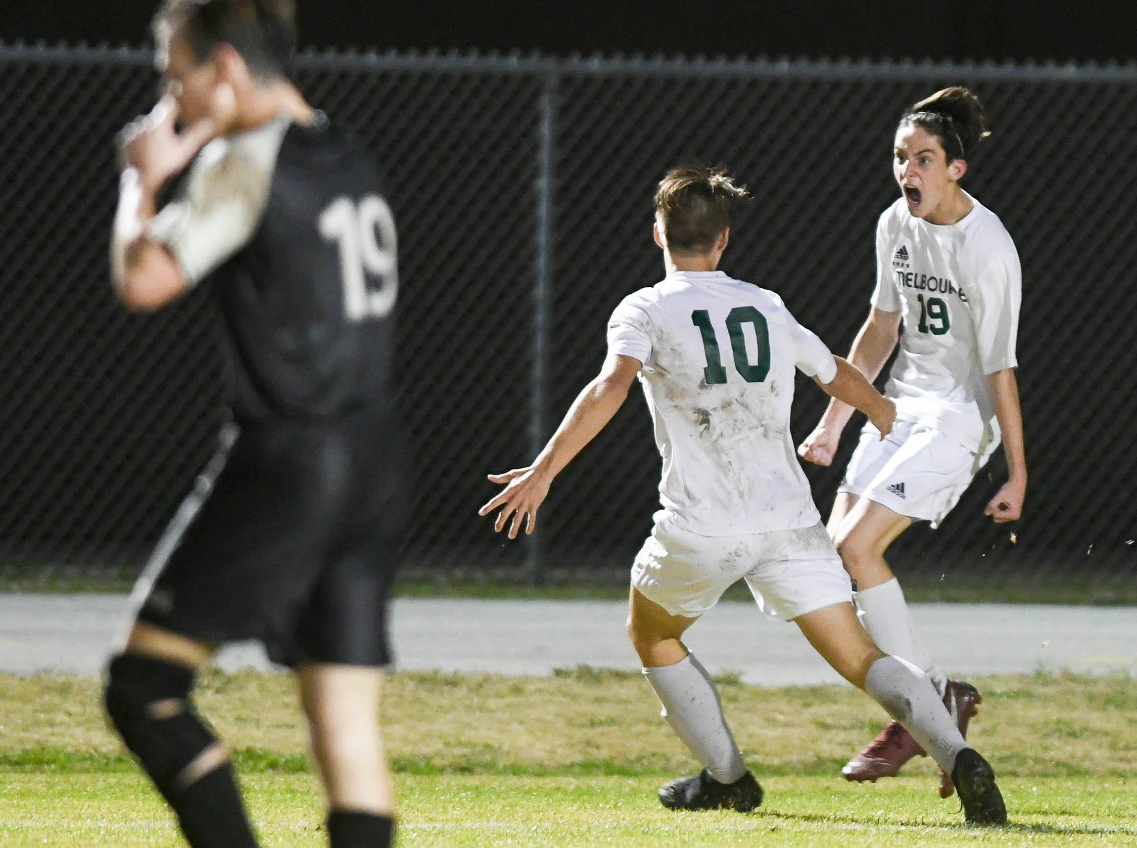 Melbourne's Christian Watts (19) celebrates a goal with teammate Aden O'Hara Friday at Viera High.
