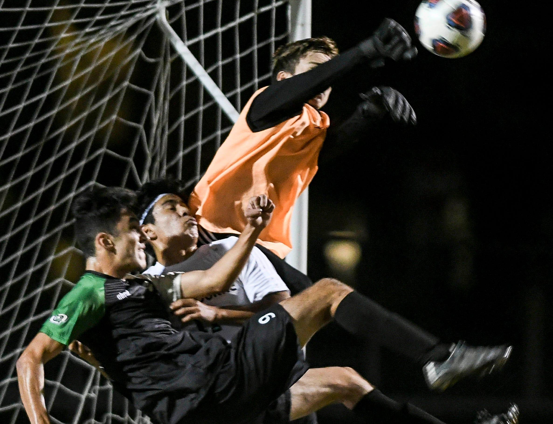 Melbourne goalkeeper Derek Mertz stops a shot on goal by Viera's Kia Mohajeri during Friday's game at Viera High.