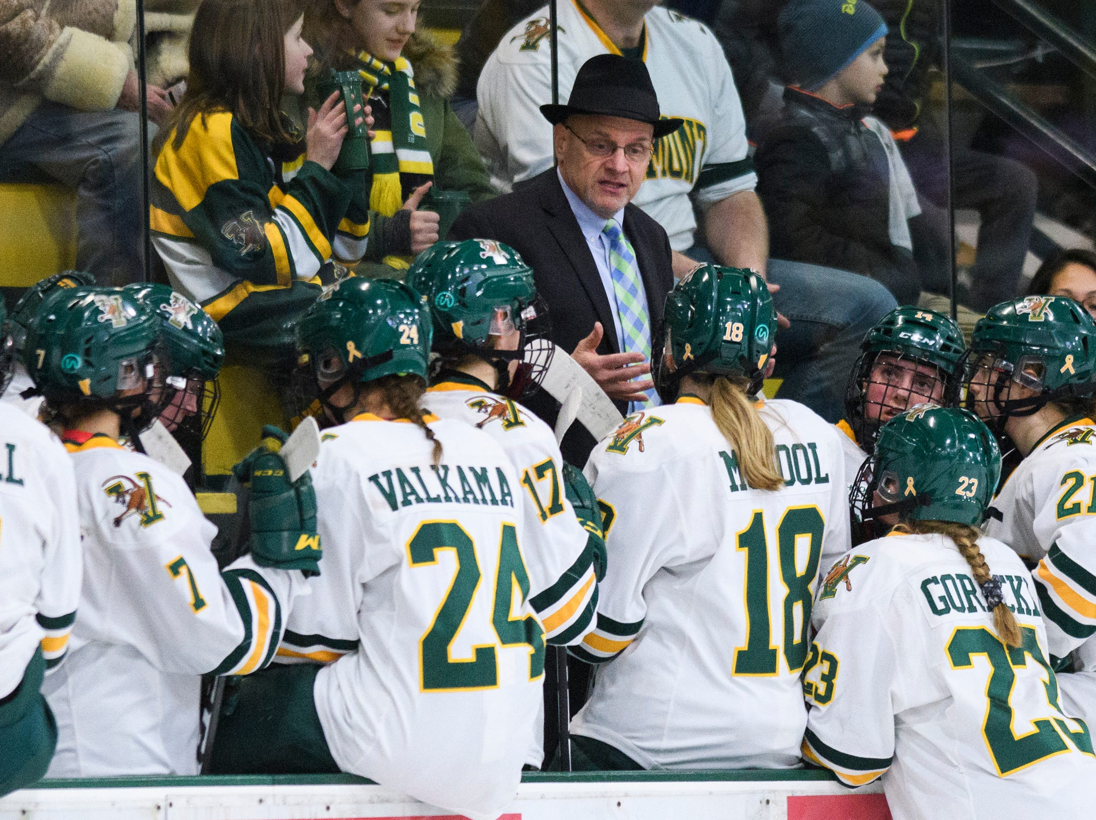 Vermont head coach Jim Plumber talks to the team during a time out in the first period of the women's hockey game between the Boston Terriers and the Vermont Catamounts at Gutterson Field House on Friday night February 1, 2019 in Burlington, Vermont.