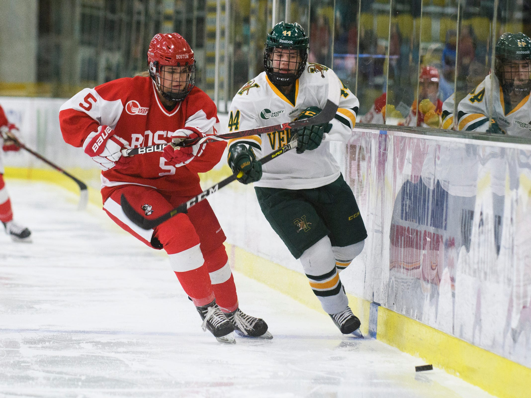 Vermont's Anna Erickson (44) and Boston's Courtney Correia (5) battle for the puck during the women's hockey game between the Boston Terriers and the Vermont Catamounts at Gutterson Field House on Friday night February 1, 2019 in Burlington, Vermont.