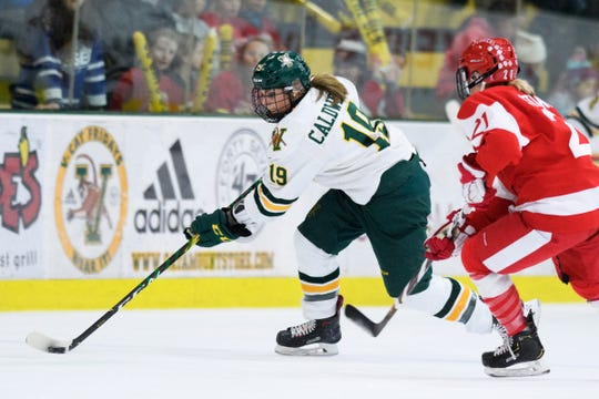 Vermont's Val Caldwell (19) skates down the ice with the puck during the women's hockey game between the Boston Terriers and the Vermont Catamounts at Gutterson Field House on Friday night February 1, 2019 in Burlington, Vermont.