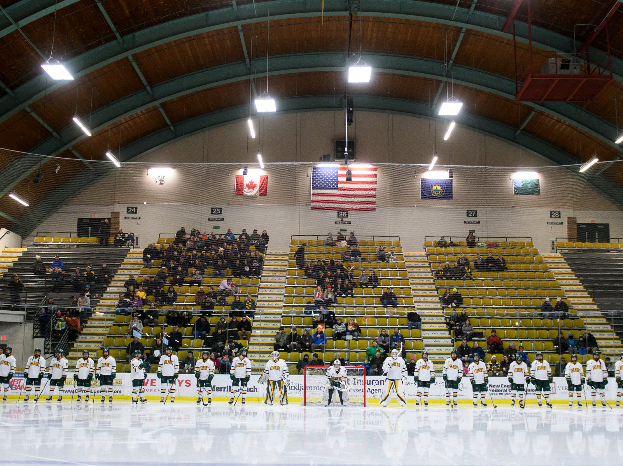 Vermont lines up on the blue line for player introductions during the women's hockey game between the Boston Terriers and the Vermont Catamounts at Gutterson Field House on Friday night February 1, 2019 in Burlington, Vermont.