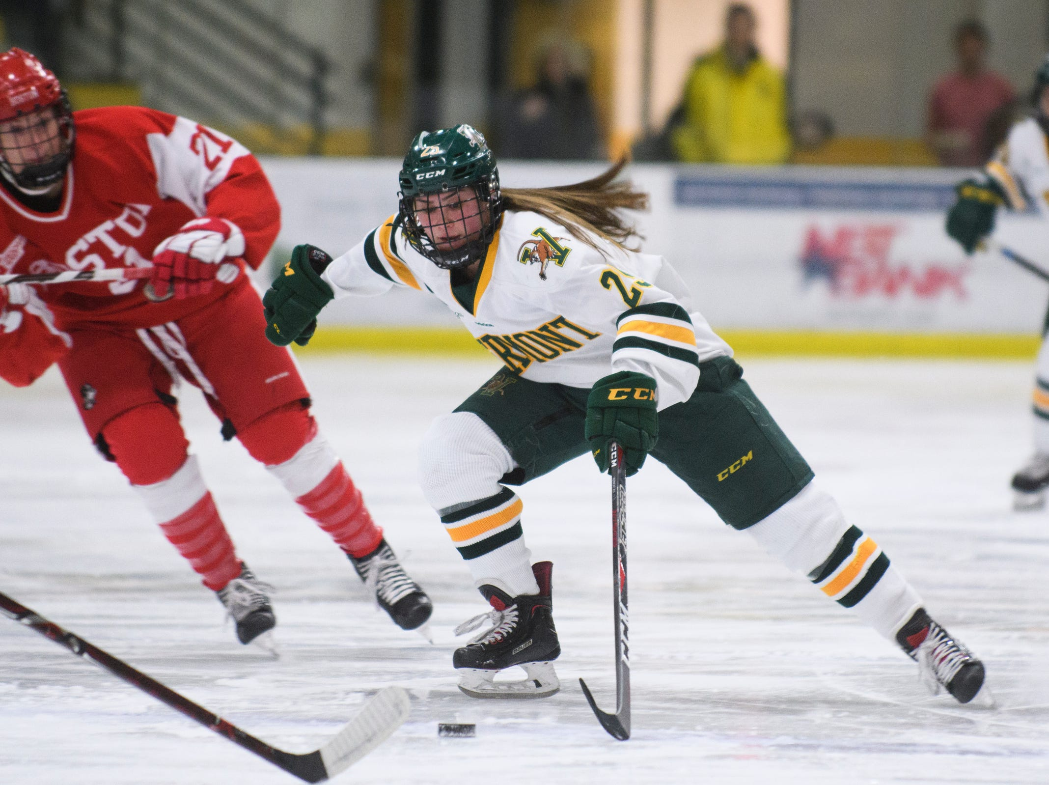 Vermont's Alyssa Holmes (25) skates down the ice with the puck during the women's hockey game between the Boston Terriers and the Vermont Catamounts at Gutterson Field House on Friday night February 1, 2019 in Burlington, Vermont.