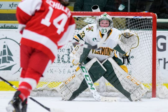 Vermont goalie Melissa Back (33) keeps an eye on the puck as Boston's Kristina Schuler (14) takes a shot during the women's hockey game between the Boston Terriers and the Vermont Catamounts at Gutterson Field House on Friday night February 1, 2019 in Burlington, Vermont.