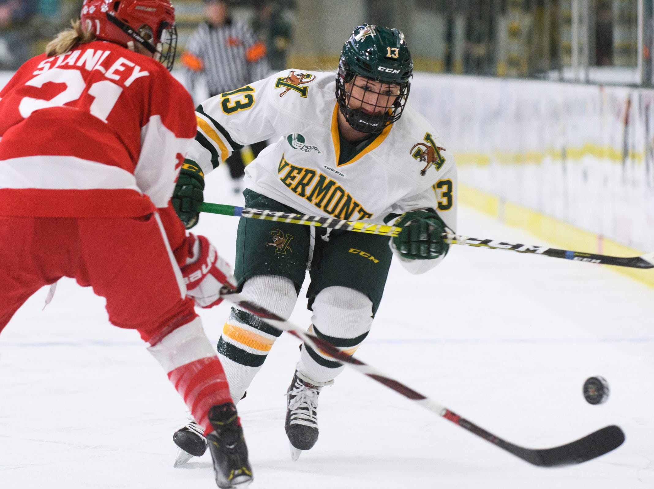 Vermont's Lilly Holmes (13) plays the puck during the women's hockey game between the Boston Terriers and the Vermont Catamounts at Gutterson Field House on Friday night February 1, 2019 in Burlington, Vermont.