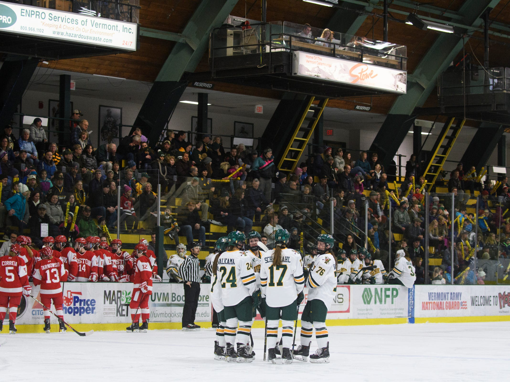 Vermont huddles together on the ice during the women's hockey game between the Boston Terriers and the Vermont Catamounts at Gutterson Field House on Friday night February 1, 2019 in Burlington, Vermont.