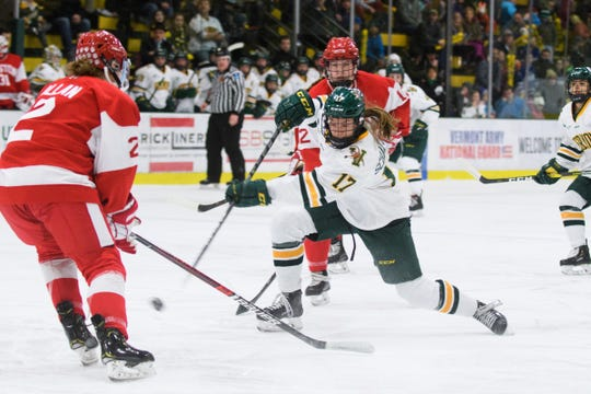 Vermont's Theresa Schafzahl (17) shoots the puck during the women's hockey game between the Boston Terriers and the Vermont Catamounts at Gutterson Field House on Friday night February 1, 2019 in Burlington, Vermont.