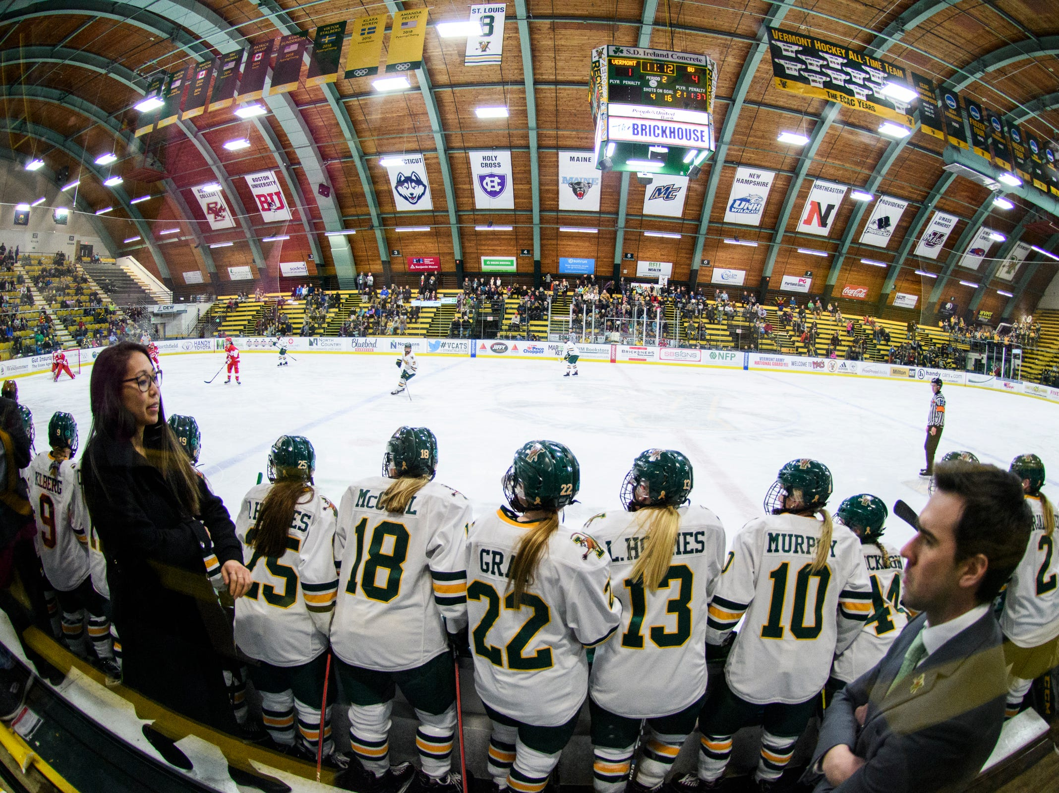 The Vermont bench watches the action on the ice during the women's hockey game between the Boston Terriers and the Vermont Catamounts at Gutterson Field House on Friday night February 1, 2019 in Burlington, Vermont.