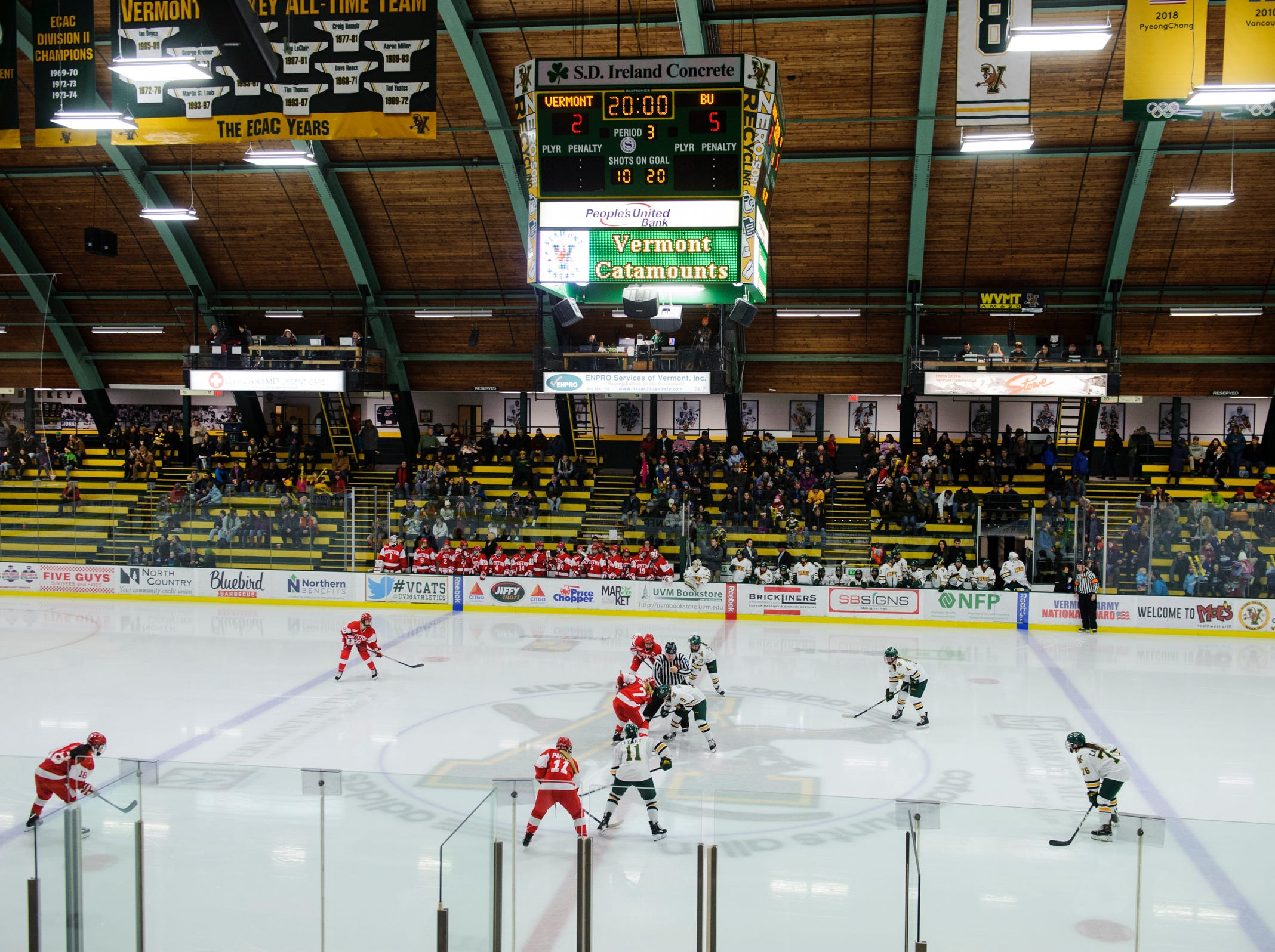 Vermont and Boston face off during the women's hockey game between the Boston Terriers and the Vermont Catamounts at Gutterson Field House on Friday night February 1, 2019 in Burlington, Vermont.