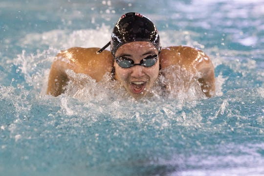 Four Bluff's Ammarie Wallett competes in the girls 100 yard butterfly during the Region VIII-5A swimming meet at the CCISD Natatorium on Saturday, Feb. 2, 2019.