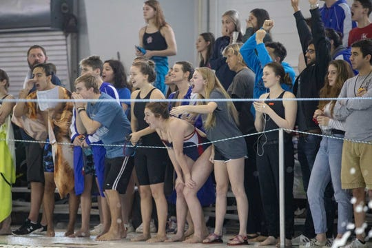 Swimmers cheer during the boys 100 yard butterfly at the Region VIII-5A swimming meet at the CCISD Natatorium on Saturday, Feb. 2, 2019.