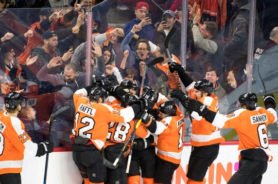 Flyers celebrate a 5-4 overtime win against the Oilers Saturday, Feb. 2, 2019 at the Wells Fargo Center in Philadelphia, Pa. Flyers won 5-4 in overtime.