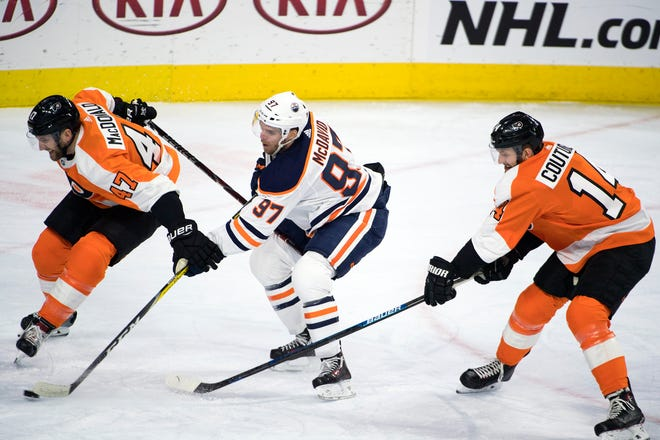 Flyers' Andrew MacDonald (47) battles Oilers' Connor McDavid (97) Saturday, Feb. 2, 2019 at the Wells Fargo Center in Philadelphia, Pa. Flyers won 5-4 in overtime.