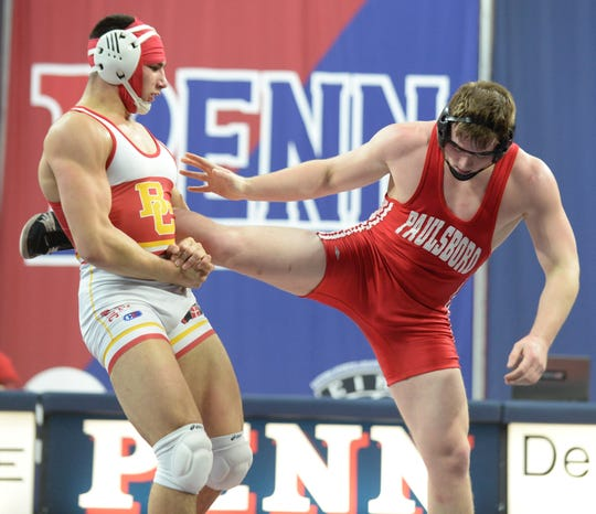 Bergen Catholic's Aj Ferrari wrestles Paulsboro's Flynn Leaf in the 220-pound bout during a wrestling match at The Palestra in Philadelphia, Saturday, Feb. 2, 2019.